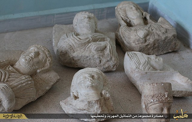 ISIS smashes priceless Palmyra artefacts
