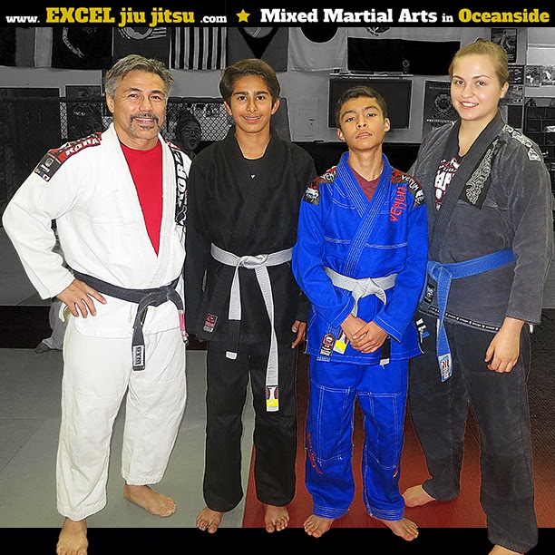 teenagers teens work on the values of respect and helping others Oceanside Martial Arts