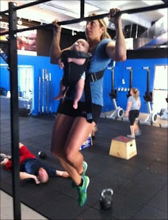 Funny picture, woman with a baby in Fitness Center