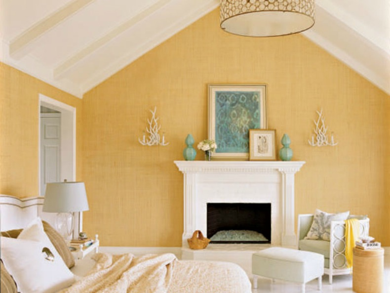 Pale yellow coastal bedroom with grasscloth walls