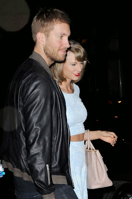 Taylor Swift in a cropped top and mini skirt on date night with Calvin Harris