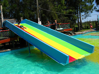 This colorful  Water-Slide  is at the teen's swimming pool