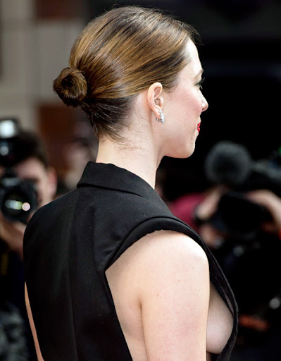 Rebecca Hall flaunted major sideboob by going braless at the premiere of Iron Man 3 in London