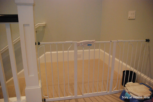 installing a baby gate perpendicular to the top of the stairs