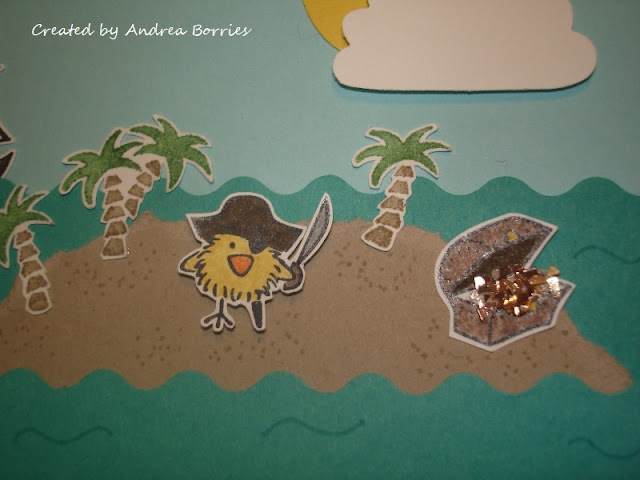 CLose up of island with pirate chickie and glitter-filled treasure chest.