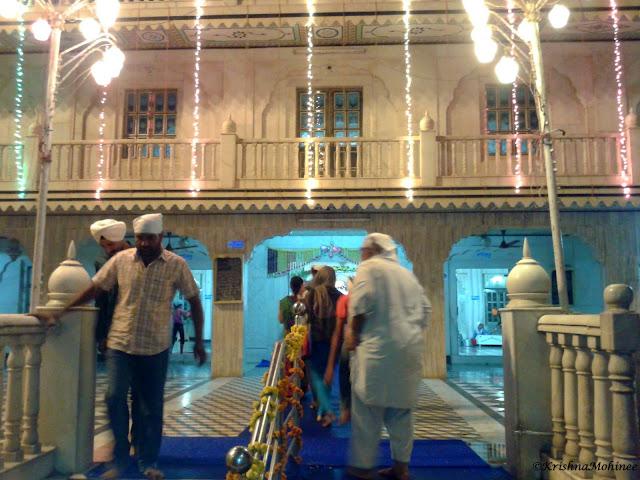 Image: Devotees going for Darshana