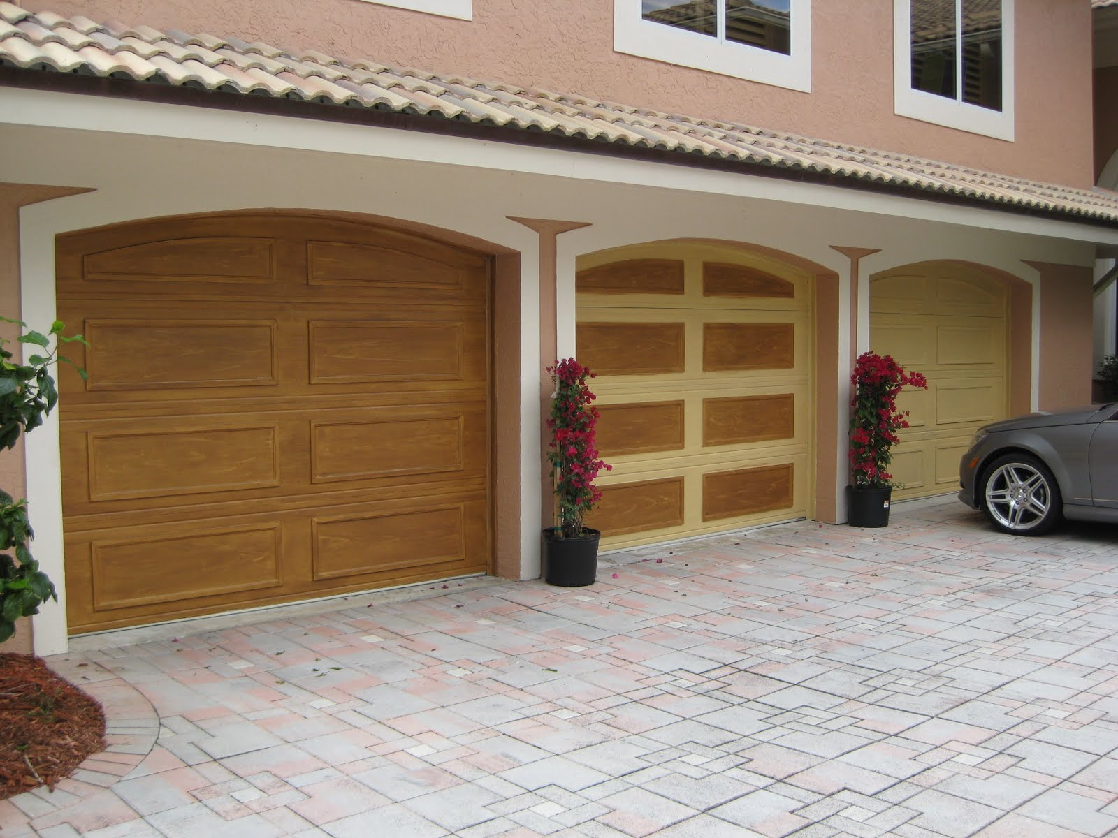 Array of color inc faux wood garage doors for Faux painted garage doors