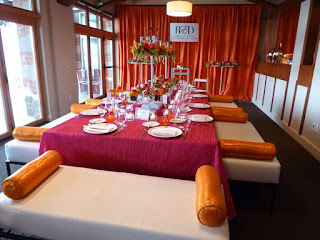 Orange and pink wedding decor at Woodmark Hotel - Photo by Patricia Stimac, Seattle Wedding Officiant