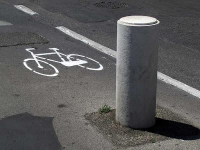 Concrete bollard in the cycle lane, Livorno
