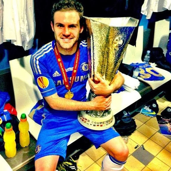 Juan Mata poses with the Europa League trophy