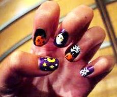 Diseño de uñas de colores por Halloween