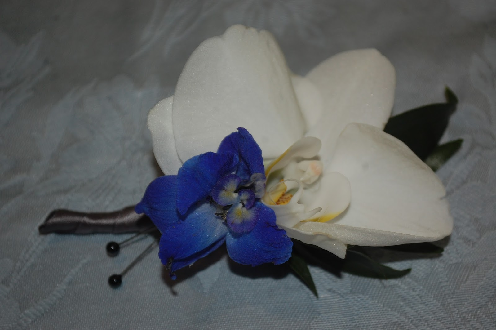 Sprouts prom flowers orchid wristlet corsage and boutonnire this is a sweet little boutonnire made from a smaller orchid and a single blue blossom izmirmasajfo