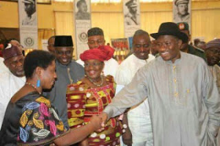Anthonia Receiving the YouWin award from Ex- President Jonathan