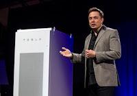 Elon Musk, CEO of Tesla. (Photograph Credit: Ringo H.W. Chiu — AP) Click to Enlarge.
