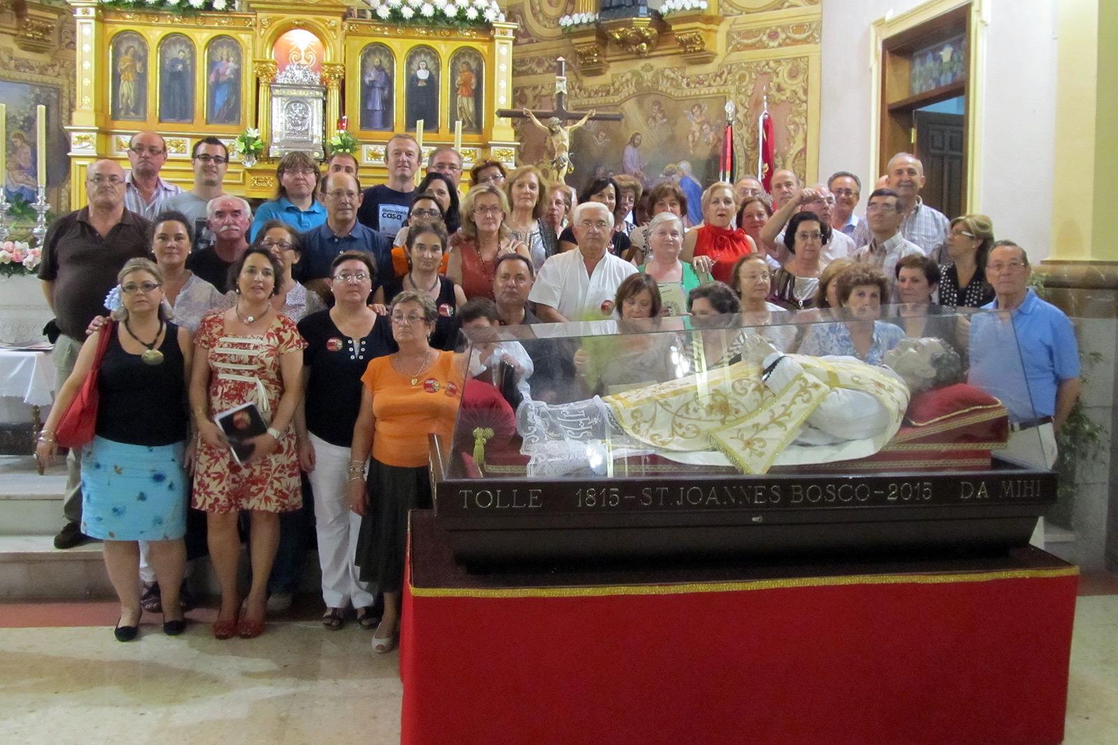 Junto a la urna de Don Bosco