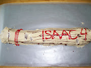 He had a baseball bat. Daddy made it just for Isaac.