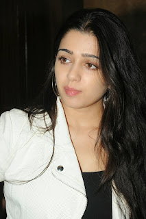 Actress Charmi Kaur Pictures in Jeans at One by Two Movie Celetes 20 Years Event 0002