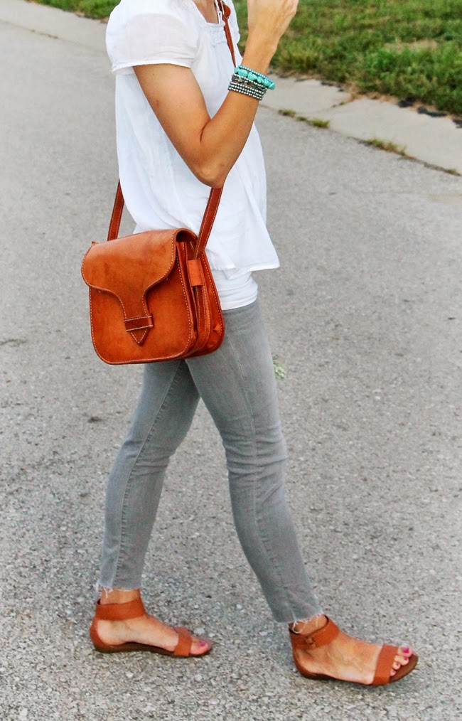 White boho blouse, gray jeans, cognac accessories