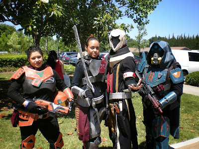Four costumers depicting characters from the video game Destiny.