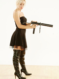 Blond girl in leather with a gun