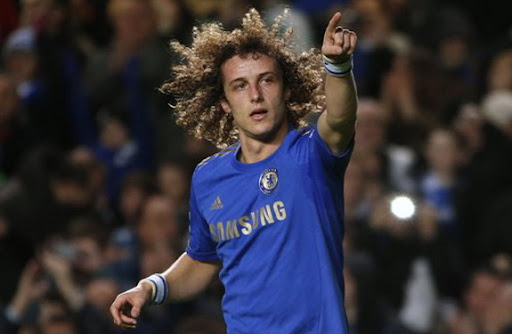 Chelsea player David Luiz celebrates after scoring a goal against Aston Villa