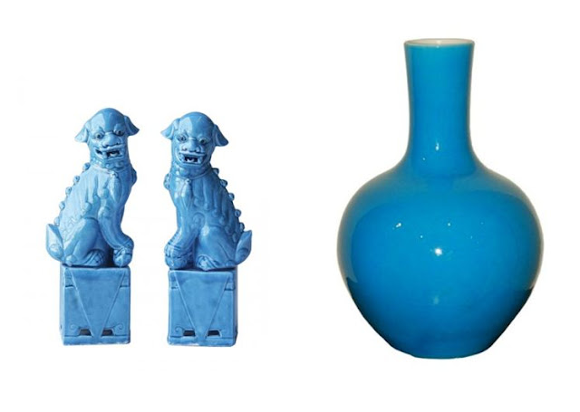 On the left two turquoise Foo Dogs, on the right a turquoise gourd vase