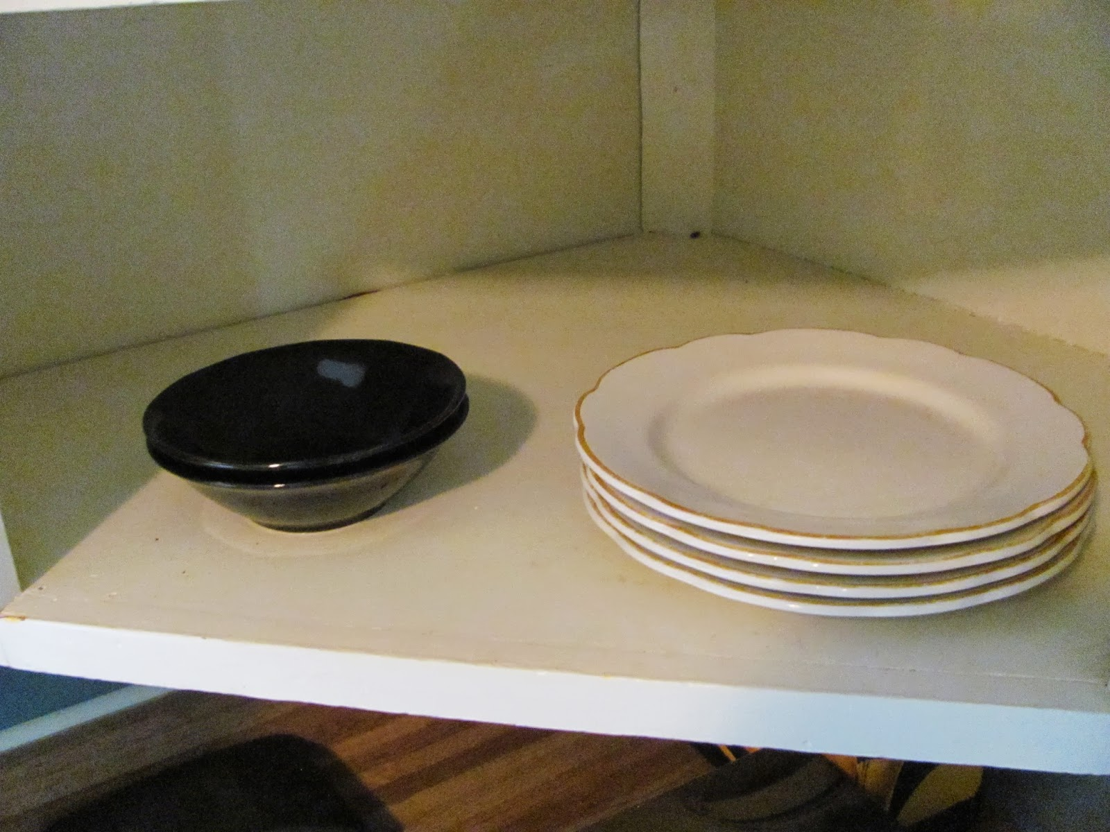 Two bowls and four plates purchased to tide us over while our real dishes are packed