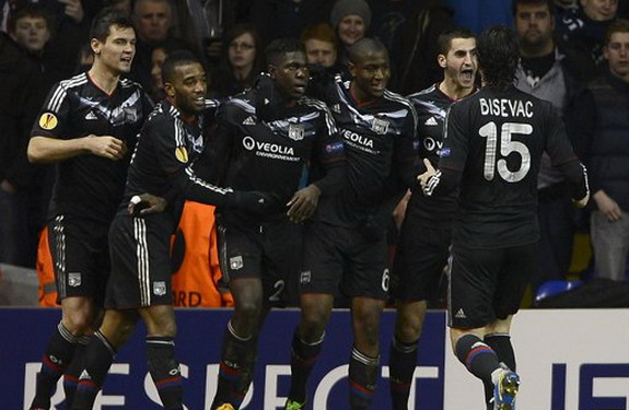 Lyon player Samuel Umtiti celebrates his equalising goal against Tottenham with his teammates