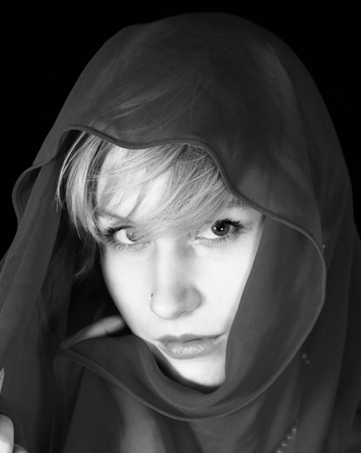 Pretty girl scarf B&W conversion grayscale with a red channel overlay in GIMP.