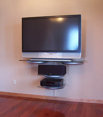 tv wall shelf advantages of having more space lowes. Black Bedroom Furniture Sets. Home Design Ideas
