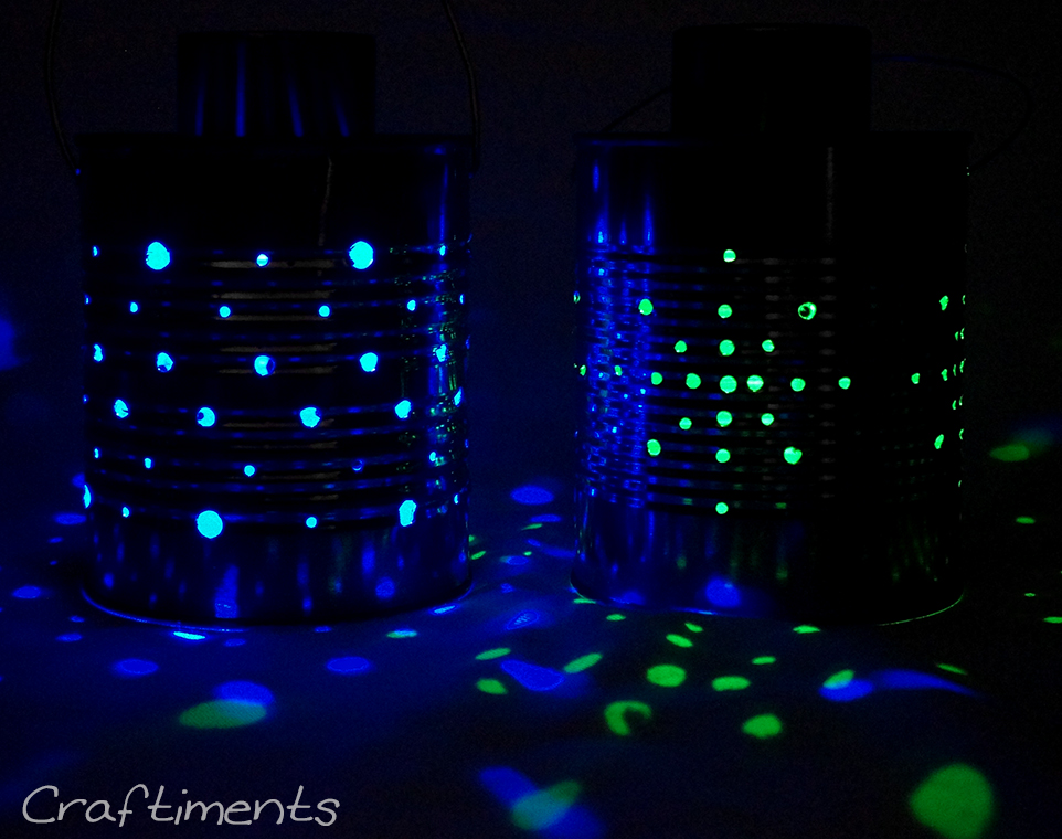 Tin can lanterns lit with color-changing solar lights.