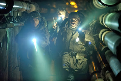 Kevin Yeger and Laurence Fishburne in The Colony