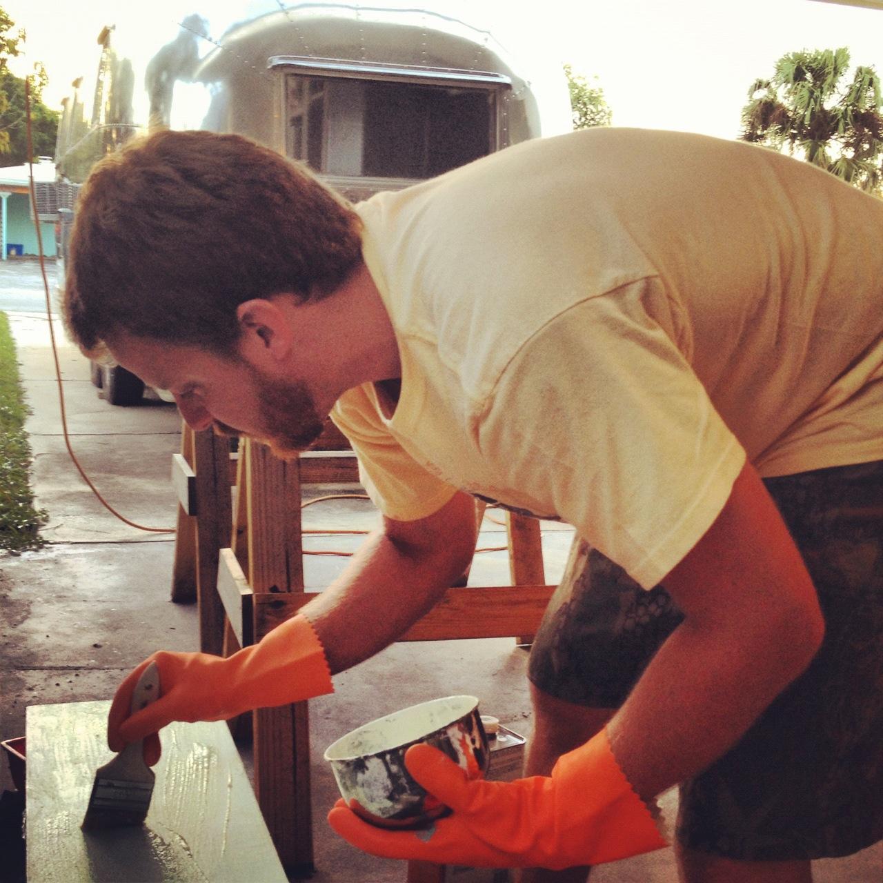 Justin applies the paint stripper