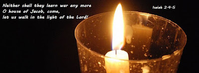single candle against dark background, with a text from Isaiah 2.4-5: neither shall they learn war any more / O house of Jacob, come, let us walk in the light of the Lord!