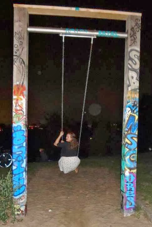 girl on swing at night