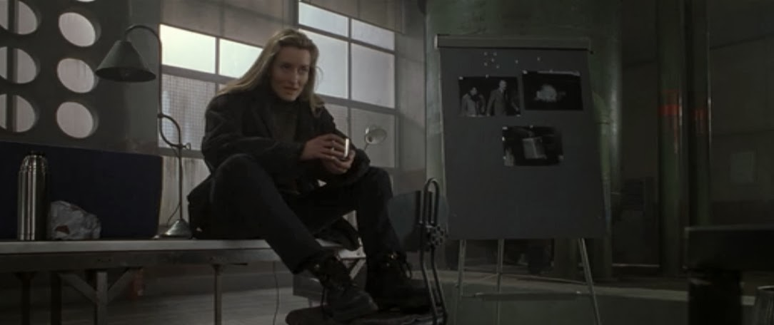 Natascha McElhone as the enigmatic and icy Irish lass Deirdre. Ronin, 1998. screenshot, sweater and overcoat, boots, costume design - May Routh