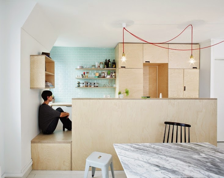 A trio of mismatched chairs surround the marble-topped table