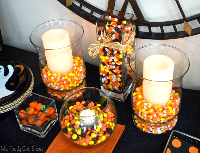 simple halloween centerpieces using candy corn and candles halloween candycorn centerpieces - Halloween Centerpieces