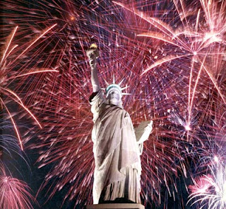 The Statue of Liberty with fireworks in the background