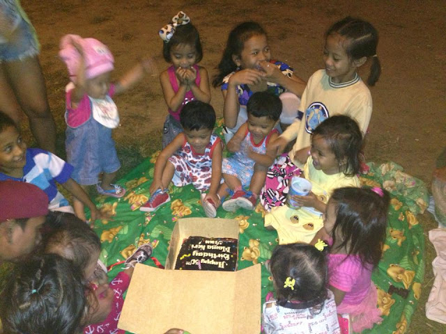 Children singing Happy Birthday