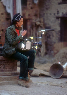 Cameraman with 16mm film camera and microphone, c. 1980