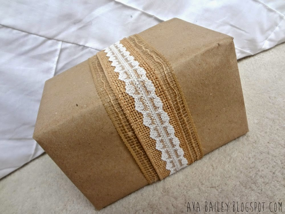 Brown paper gift wrap with burlap ribbon and lace