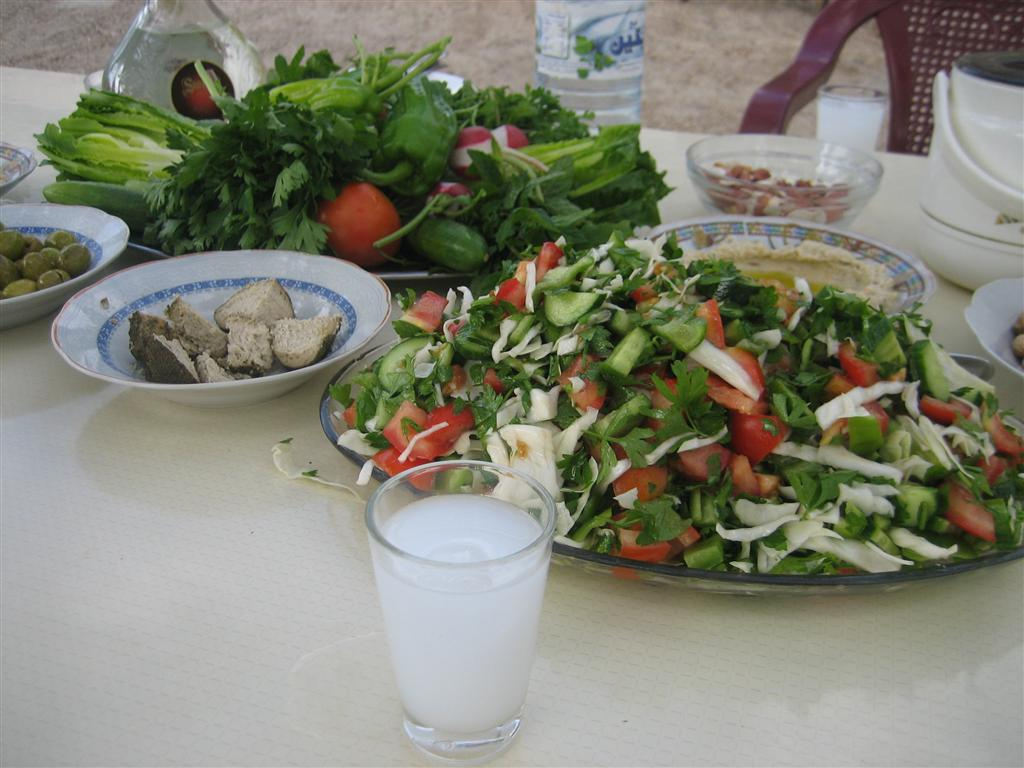 Image result for arak and water with lebanese food images