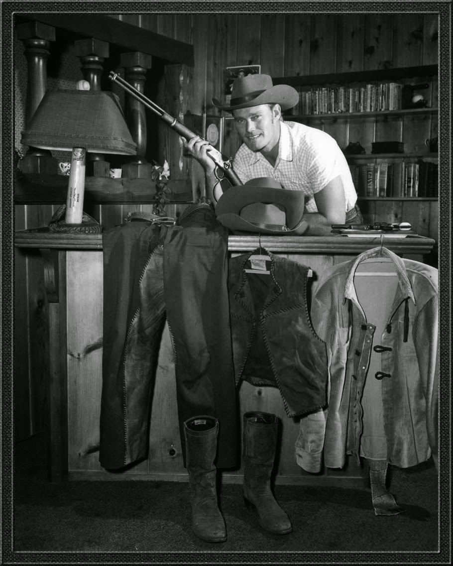 Chuck Connors at home back in his Rifleman days surrounded by items from the show.