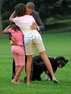 Obama e seus cães com a família