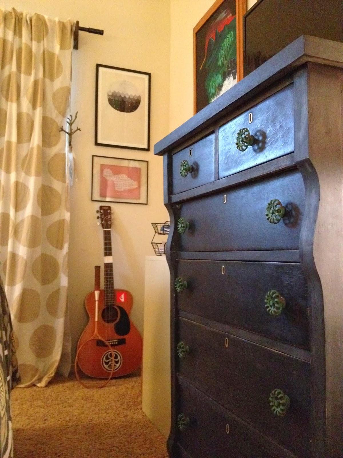 black antique dresser wizard of oz polka dot curtains guitar tennis racket