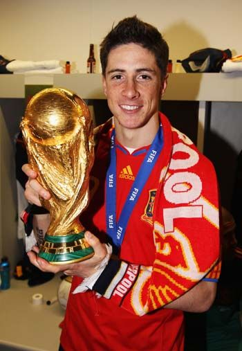 Stylish Fernando Torres With The World Cup Trophy Sporting A Smart
