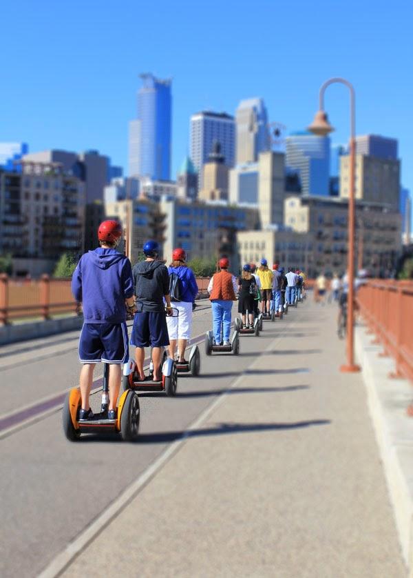 segway riders on the stone arch bridge in Minneapolis, MN