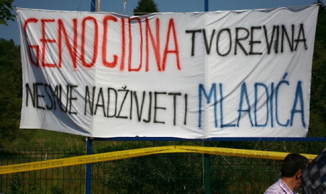 "Srebrenica, Bosnia-Herzegovina. ""Genocidal Creation Must Not Outlive Mladic"" says the banner just outside the Srebrenica Genocide Memorial in Potocar. It refers to 'Republika Srpska', the Serb controlled part of Bosnia-Herzegovina and Gen. Ratko Mladic responsible for the July 1995 massacre of 8,000 Bosniak men and boys during the fall of Srebrenica. Photo by Dominik Sipinski (July 11, 2011)."