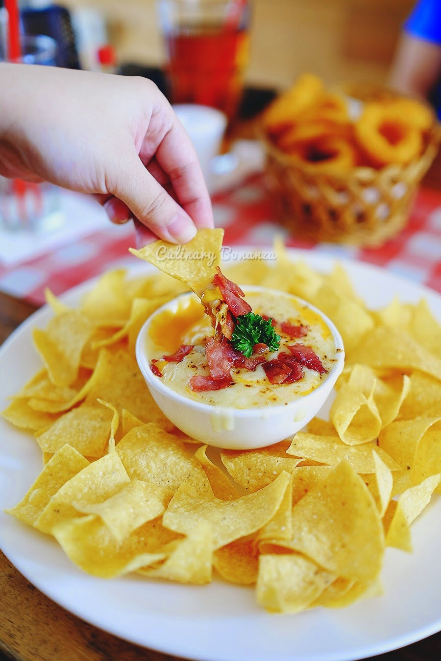 TCG Nachos, served with super rich Cheesy Burger Dip made with generous minced meat, bacon, salsa, mozzarella cheese, cheddar cheese & jalapeno
